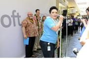 Noelle Neverdon, store manager of the new Microsoft Store welcomes people to the grand opening at Ala Moana Center.