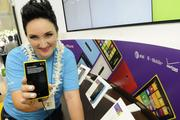 Noelle Neverdon, manager of the Microsoft Store at Ala Moana Shopping Center, shows off the Nokia Luonia 920 Windows 8 phone.