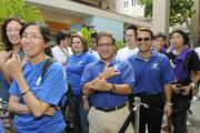 Isaac Sakamoto, center, program director for the Nuuanu YMCA, throws a shaka while waiting in line outside of the new Microsoft Store at Ala Moana Center.