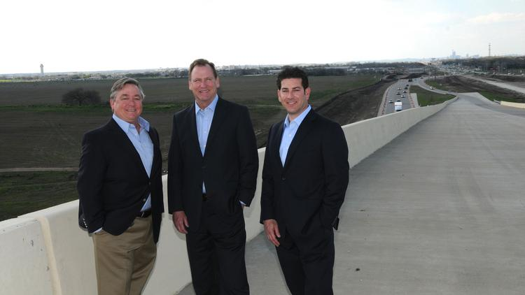 From left: George Robinson III, Doug Launius and Karl Koebel, manage the development company building the Velocity Crossing mixed-use project in Southeast Austin.