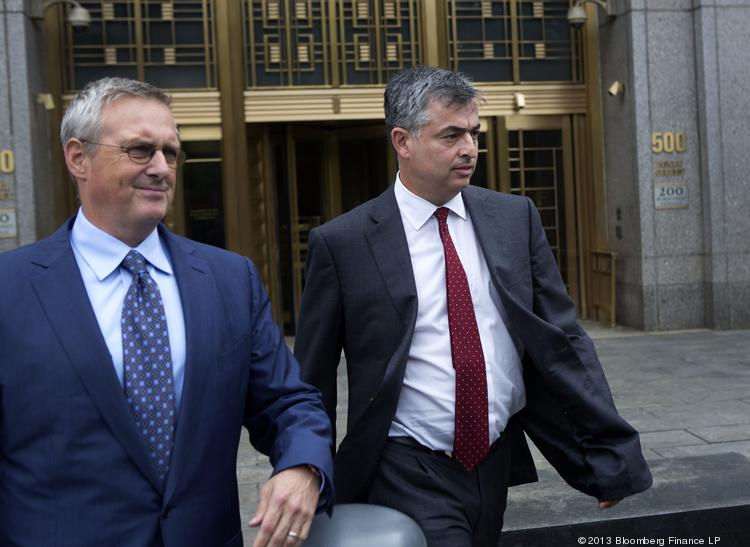 """Eddy Cue, the Apple executive the government claims was the """"chief ringleader""""of a scheme to fix e-book prices, right, exits federal court in New York, U.S., on Thursday, June 13, 2013."""