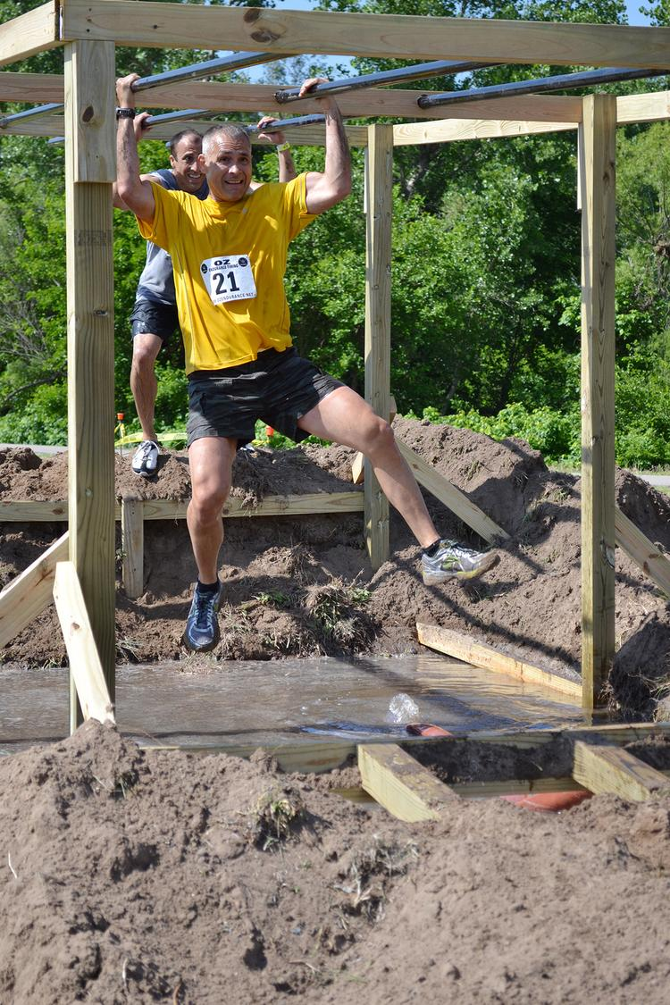 If racers lost their grip on these monkey bars, they'd fall into a pit of mud.