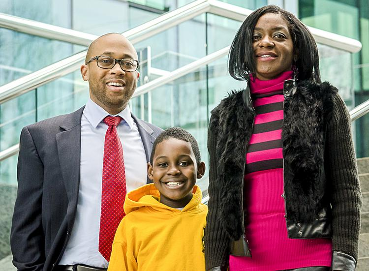 """DLA Piper LLP attorney Jamaal """"Jay"""" Stafford, left, worked pro bono to help Kaneka Malone retrieve her son, Chevor Malone Jr., who had been abducted by his father. After getting him home, doctors discovered the boy had an untreated cancerous lump."""