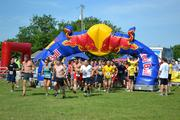The first wave of racers takes off at Gladiator Dash, a fundraiser for Newman University athletics and the Child Advocacy Center of Sedgwick County. Red Bull was one of the sponsors.