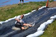 This obstacle required competitors to run up a hill, slide down, then run back up and down.