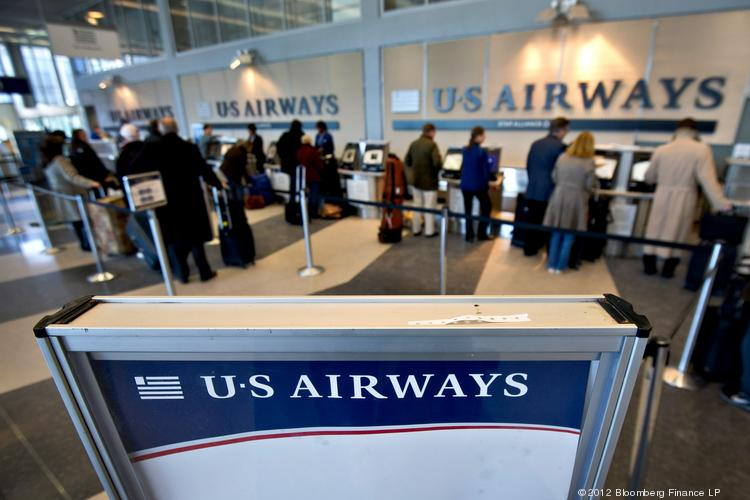 Passengers check in for US Airways flights at O'Hare International Airport.