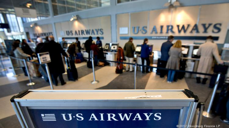 Passengers check in for US Airways Group Inc. flights at O'Hare International Airport in this file photo.