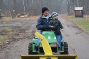 """This is my father, Richard Siemers, practicing the long-held family ritual of driving our youngsters around on his tractor at the family home in Minnesota. This shot is from November 2009, and the youngster is my then 3-year-old son, Quinn.  I usually blanche at the use of overly positive bromides. I'm immune to the effects of self-help books, motivational posters and most varieties of pep talk.  Some of that you could attribute to the kind of cynicism inherent in most journalists. But I like to think it's because I've already taken to heart a lifetime's worth of lessons from one of the most positive people I know — my father. One (of several) things I've taken away from my dad over the years is this simple mantra: """"It never hurts to try."""" It's not exactly a credo embroidered upon the family crest. And frankly, it's not advice that works universally — there are certainly things someone can try that, in fact, hurt very much. Yet it's the broader message that sticks.  What my dad taught me was a formula for creativity and innovation: Don't be afraid to be different, to test something new, to expand your horizons. You can say it a million different ways, but the message stays the same. A person's only as creative as their ambition allows them to be. What my dad taught me was how to act on that ambition, and I'm a lucky man for it. Happy father's day, Dad. - Erik Siemers, managing editor"""