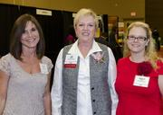 Kathy Moore and Natalie Pruitt support North Texas Food Bank honoree Jan Pruitt (center).
