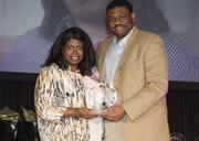 Kevin Davis of event sponsor TCU's Neeley School of Business with honoree Eve Clark of MEB Construction