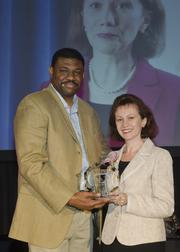 Kevin Davis of event sponsor TCU's Neeley School of Business and honoree Bella Goran of American Airlines.