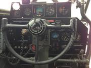 The pilot's instrument panel. Notice the Garmin GPS on the left and a few updated instruments for more modern flying, including a row on the top. But the rest of the panel is the way it was during World War II.