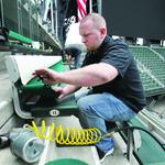 Meet the real stars of baseball's opening day: Folks who paint seats, print shirts, plant sod
