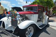 The free event had adults and children admiring cars like this 1930 Ford Model A ...