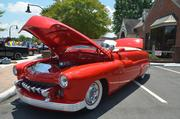 ... and this custom Mercury Model 51 red convertible.