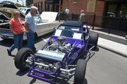"""A couple checks out this V8 Sand Rail Hot Rod. Its description says it's painted a """"Lolipop Candy Purple"""" and has a 383 Chevy Stroker."""
