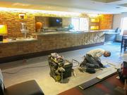 A worker puts finishing touches on the Embassy Suites' new bar. The bar is one feature of the $14 million renovation the hotel recently received to convert it from the Tremont Suites Hotel.
