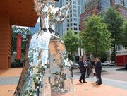 Baoding, China Vice-Mayor Zhou Xingshi stops to admire The Firebird, a sculpture by French-American artist Niki de Saint Phalle outside the Bechtler Museum of Modern Art. Zhou led a delegation of officials and business executives from his city on June 17 and 18 to learn more about Charlotte's growing energy cluster and the city's management of government functions including sustainability.