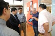 A delegation of officials and business executives from Baoding, China toured Charlotte on June 17 and 18 to learn more about the city's growing energy cluster. Monday's vist included a stop at Packard Place where they spoke with its co-founder Dan Roselli.