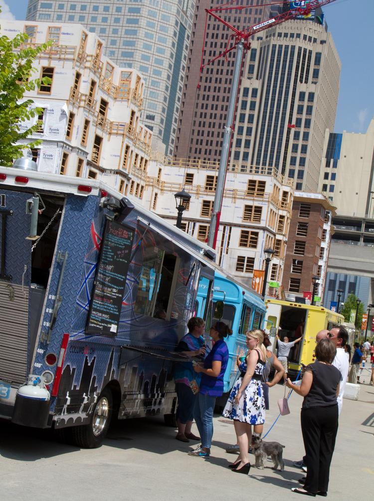 Food trucks lined up to serve customers in downtown Columbus.