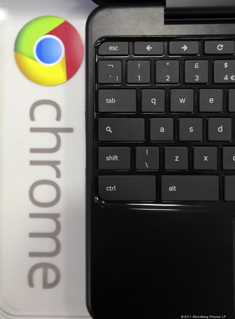 The logo of Google Chrome is seen alongside a Samsung Electronics Chromebook laptop.