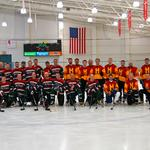 Real estate pros play hockey for charity