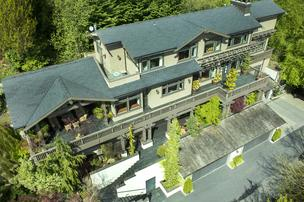 An aerial view of OB Jacobi's elegant Craftsman-style Seattle home on a private lane in Laurelhurst. The 6,100 square foot home, which this president of Windermere Realty  built 11 years ago, just went on the market for $3.25 million. Photo: VHT