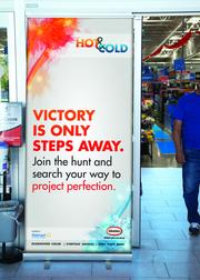 This sign from University of Miami students tells Walmart shoppers they're only steps from the paint display.
