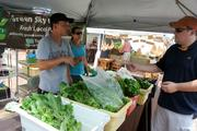 Green Sky Growers are part of the market, and a big part of the community. Sean Dodge and Jen Holdsworth run the farmers market table and the facility.