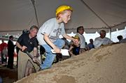 Jasper Fortwengler, 8, climbed the mountain of sand that symbolically was shoveled to start the downtown portion of the Ohio River Bridges Project.