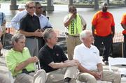 Yarmuth, left, Louisville Mayor Greg Fischer and Kentucky Gov. Steve Beshear listened during the ceremony.