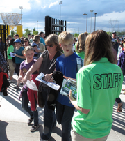 A Hillsboro Hops staff member greets some of the first game-goers at opening day.