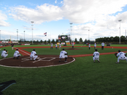 A group lines up to throw out the traditional first pitches before Monday evening's Hops game.