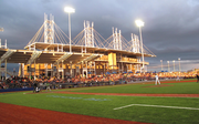 A beautiful sunset casts its shadow on the packed stands at Monday evening's inaugural Hillsboro Hops home game.