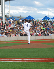Jose Martinez throws the first pitch in the Hops' inaugural opening home game.