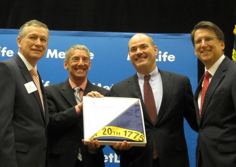 Gov. Pat McCrory (far right) announced Thursday that MetLife (NYSE: MET) plans to bring 2,600 jobs to North Carolina.