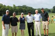 Local sports figures and TV personalities, from left: ESPN analyst Jay Bilas, WFNZ-AM radio host Taylor Zarzour, WCNC-TV meteorologist Megan Danahey and Carolina Panthers wide receiver Steve Smith; First Tee Executive Director Ike Grainger; and Golden State Warriors guard Stephen Curry. The group joined The First Tee of Charlotte for the organization's inaugural celebrity golf match to encourage local youth.