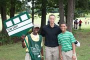 Stephen Curry won The First Tee of Charlotte's inaugural celebrity golf match. Here, he poses for a photo with young players Marlon Newman and Jalen Roberts.