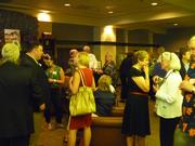 Attendees mingle during Mona's retirement party.