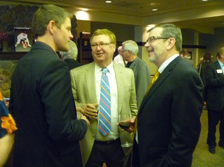 Dave Mona (center) chatted with University of Minnesota President Eric Kaler at Mona's retirement party Tuesday night.