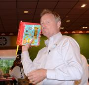Ric Florell, Universal senior vice president of revenue operations, with the Simpson's Encyclopedia, used for referencing everything in Fast Food Boulevard.