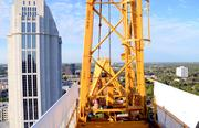 Here's Frank, climbing from the operator's nest to the top of the crane.
