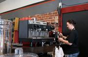 McNelly prepares a cup of the store's cold-brew coffee.