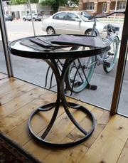 The bicycle theme is not just a part of Reverie's logo. This table and other items in the store are made of old bicycle parts, and Gough says the business is bicycle-friendly, with bike racks available outside.