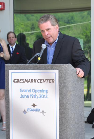 James Bouchard speaks at the grand opening of Esmark Inc.'s new headquarters.
