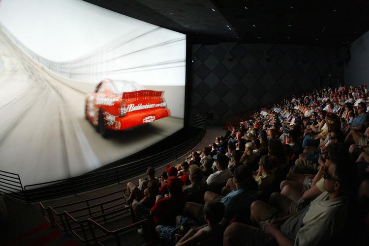 The audience watches a film at the Pepsi IMAX Theatre at DAYTONA USA, the official attraction of NASCAR