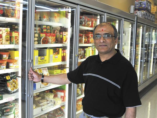 Store Growth: Devendra Patel, owner of Shree-G Grocers in Miami Township, is a native of India.