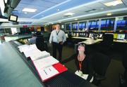 Operations Supervisor Raissa Psinka, right, and Director of Airfield Operations Nino Sapone look over monitors displaying airfield sensors in the Pittsburgh International Airport's emergency operations center.