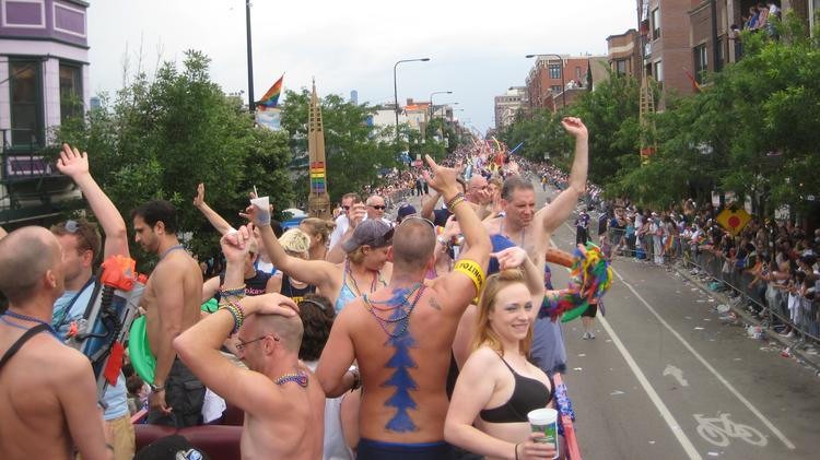 People wave from a float during the 2008 Pride Parade in Chicago. (Photo by Tony. Used under Creative Commons license.)