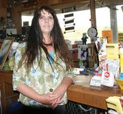 "Tammera Snyder, co-owner of Snyder's Marina at Cheney Reservoir, is affected by the declining water levels. ""It's killing the business,"" she says."